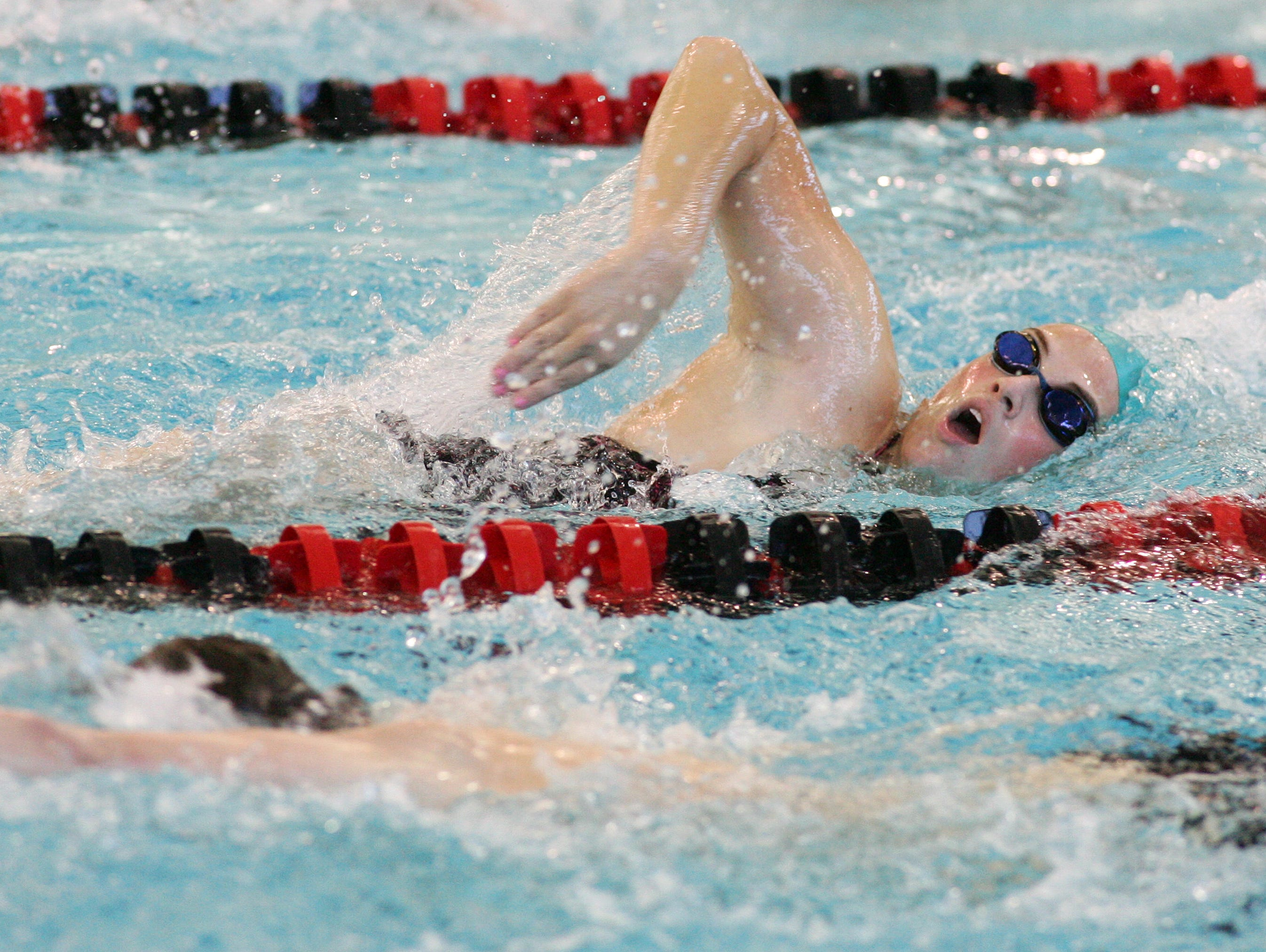 Watkins Memorial senior Chelsea List practices her freestyle during a practice Nov. 24 at Denison.