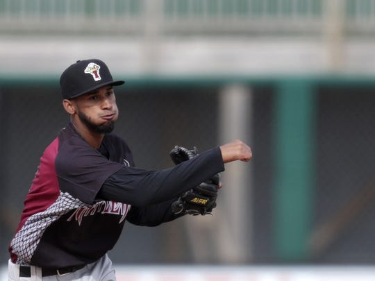 Wisconsin Timber Rattlers' Jonathan Oquendo throws
