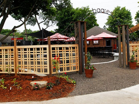 A wooden fence and gateway with the baaree's name in metal define the space for the new beer garden next to the Cheel in Thiensville.