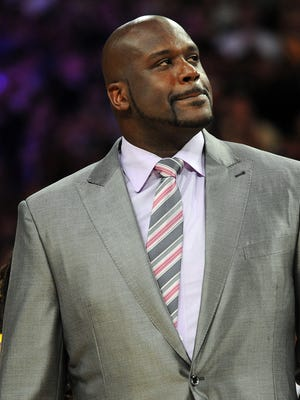Shaquille O'Neal, whose jersey was retired by the Lakers in April, will buy a stake in the Kings.