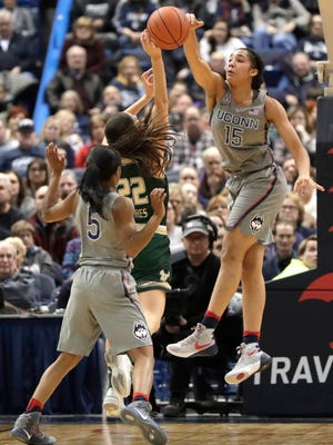 Connecticut guard Gabby Williams (15) blocks then shot of South Florida guard Laia Flores (22) in the first half.