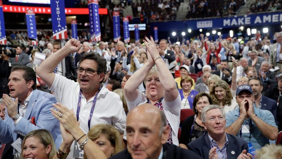 Delegates react as some call for a roll call vote on