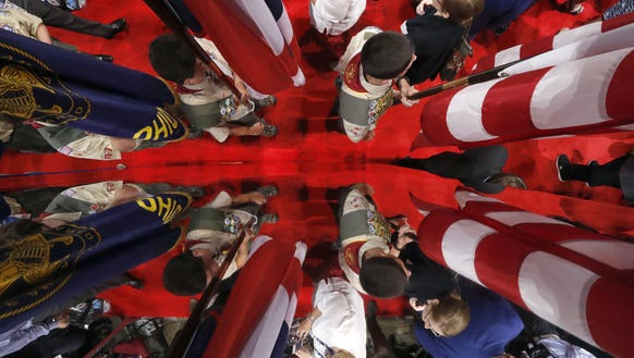 A local Boy Scout troop from Rocky River, Ohio is reflected
