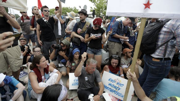 Demonstrators sits down near the AT&T Station as police