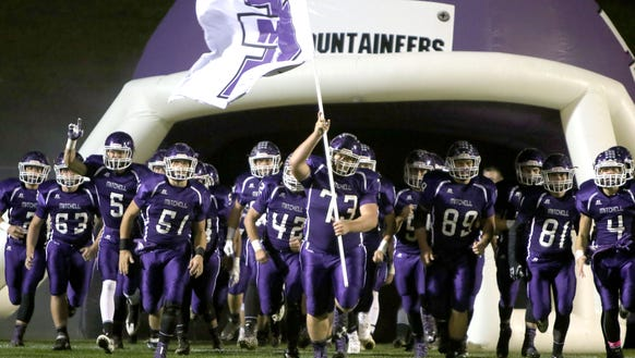 Mitchell football players take the field for last Friday's