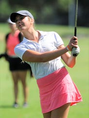 Wylie's Maddi Olson watches her second shot on No.