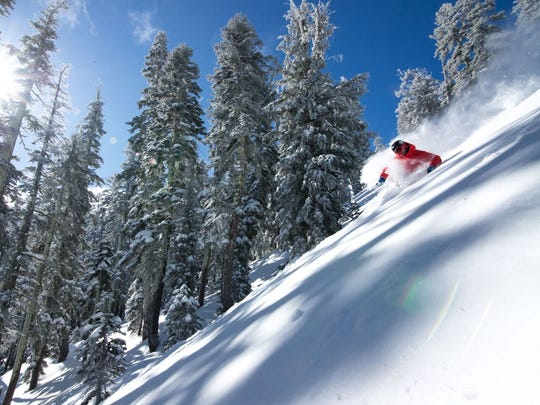 Skiers enjoy the terrain at Alpine Meadows.