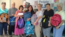 People to People's Diane Serratore (center) receives donations from members of the Clarkstown Retired Teachers.