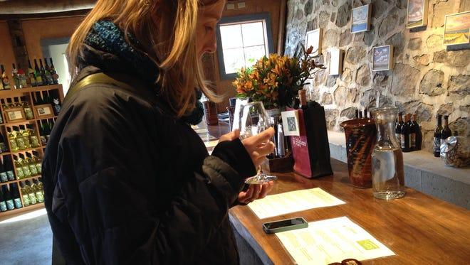 Kim Meyer tastes Billsboro wines paired with CaryMo chocolates.