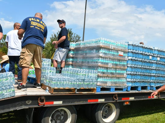 united Way gives out free water in Palm Bay