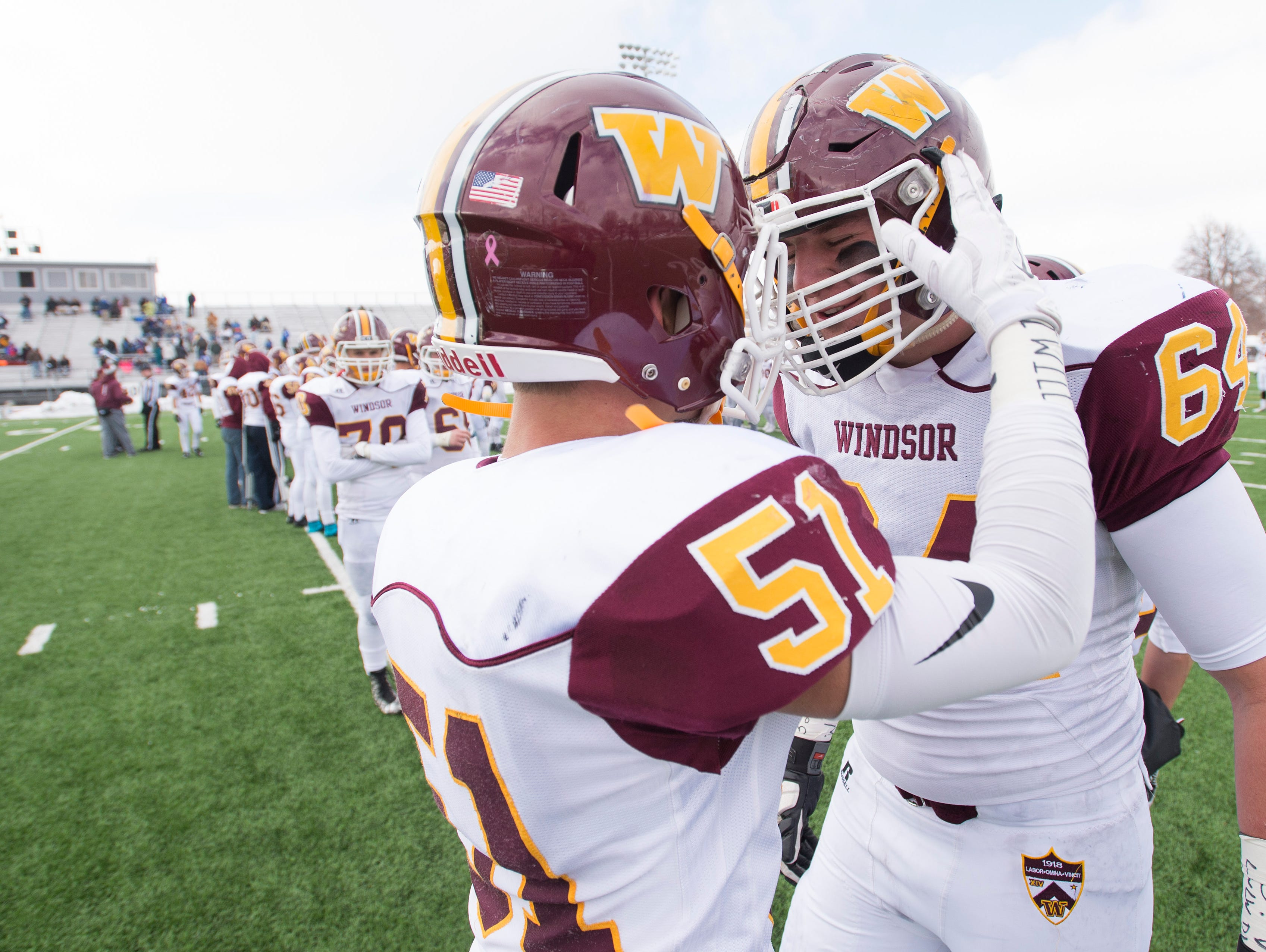 Windsor High School football players Josh Bloss and Zach Watts warm up before the team takes on Longmont in the 4A State Semifinal at Everly-Montgomery Field in Longmont Saturday, November 28, 2015.