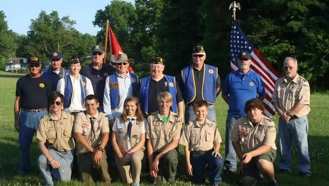 Flag retirement ceremony conducted on Wednesday June 14,2107 (flag day) by the American Legion Post 48 and Boy Scouts Troop 3027 Morganfield. Participants include back row left to right Dickie Berry, Bob Buckman,  Dawn Hedgepath, Lark Buckman, Bill Butler, George Blakeley, JW Heidrich, Harvey Musser and Jim Padgett. Front row left to right David Johnson, Zake Walker, Haley Gibbs, Shane Gibbs, Nicky Gibbs, and Dakota Padgett