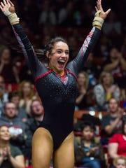 Southern Utah gymnast Tyly Bozzuto celebrates after