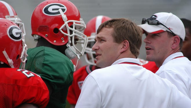 Kirby Smart with Mike Bobo in the background