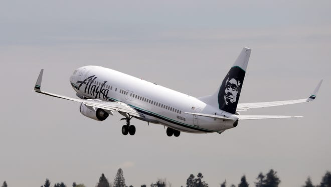 In this file photo from April 23, 2013, an Alaska Airline jet takes off from Seattle-Tacoma International Airport.