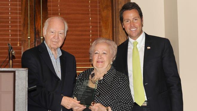 From left, historian and editor emeritus of the Pensacola News Journal J. Earle Bowden, honorary Vice Consul to Spain Maria Davis and Pensacola Mayor Ashton Hayward.