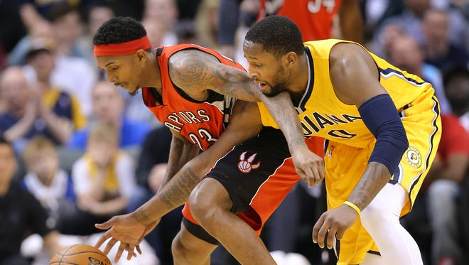Indiana Pacers guard C.J. Miles and Toronto Raptors guard Louis Williams scramble for a loose ball in the first half of the game at Bankers Life Fieldhouse on Monday, March 16, 2015. The Pacers lost 117-98 to the Raptors.