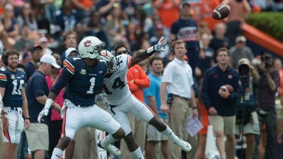 Auburn defensive back Stephen Roberts deflects a pas intended for Auburn wide receiver D'haquille Williams during the Auburn A-Day spring game on Saturday, April 18, 2015, at Jordan-Hare Stadium in Auburn, Ala.