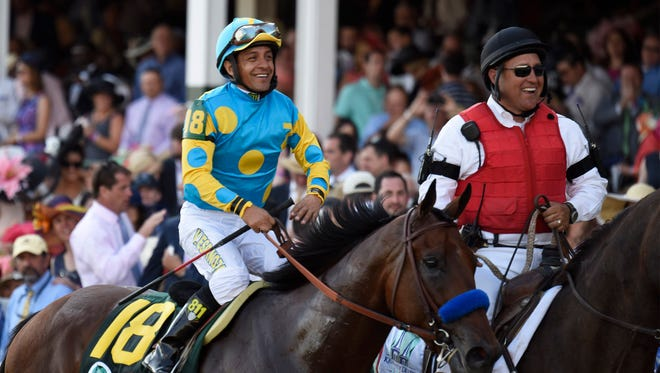 Kentucky derby winner Victor Espinoza celebrates in front of the crowd atop his horse American Pharaoh on May 2, 2015, at Churchill Downs racetrack. This was Espinoza's second consecutive Kentucky Derby win.