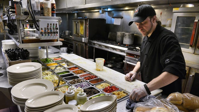 Louis Brott, executive chef at Anton's, cleans up and gets ready for the changeover from lunch to dinner Friday in Waite Park. The restaurant received high marks during the 2014 inspections.