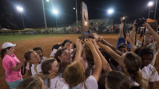 Wetumpka celebrates as the Indians receive the trophy for the AHSAA Class 6A State Championship on Saturday at Lagoon Park. Southside-Gadsden 3-2 in a deciding game.