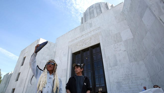 """Quinten Bettles, left, and Jay Nelson, both with a group called """"Honor the Treaty of 1864,"""" gathered at the Oregon State Captiol on Wednesday, June 24, 2015, in Salem, Ore. Tribal members at the rally raised various issues including tribal water rights in the Klamath Basin, Senate Bill 133, and the LNG Pipeline."""