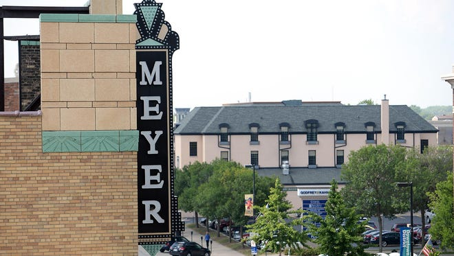 The Meyer Theatre sign overlooking Washington Street in Green Bay viewed from the rooftop of Backstage at the Meyer.