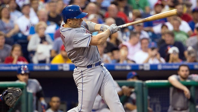 New York Mets third baseman David Wright (5) hits a solo home run during the second inning against the Philadelphia Phillies at Citizens Bank Park.