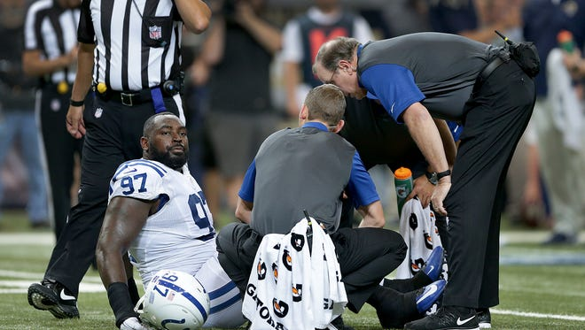 Indianapolis Colts defensive end Arthur Jones (97) is tended to by the Indianapolis Colts training staff in the first half of their game Saturday, August 29, 2015, evening at the Edward Jones Dome in St. Louis MO.