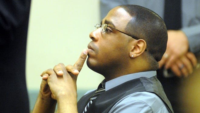 Peter Henriques listens on Jan. 12, 2012, as Judge Benjamin Telsey issues his sentence for aggravated manslaughter.