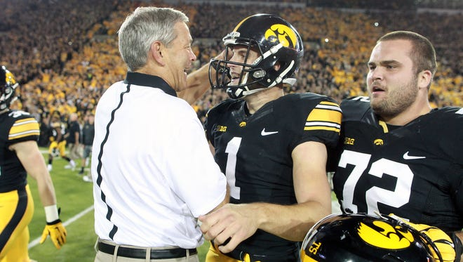 Iowa head coach Kirk Ferentz congratulates kicker Marshall Koehn after his 57-yard game-winning field goal to beat Pittsburgh at Kinnick Stadium on Saturday, Sept. 19, 2015.