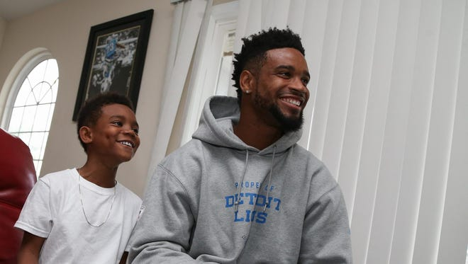 "Lions cornerback Darius Slay plays the ""Madden 16"" video game with with his 8-year-old son, Darion, on Tuesday."