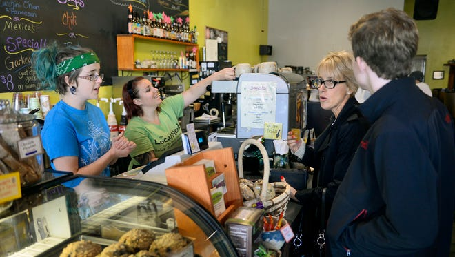 Baristas Alex Swingley, left, and Vahna Ahlbrecht take orders Friday, Oct. 16, at The popular Local Blend coffee shop in downtown St. Joseph.