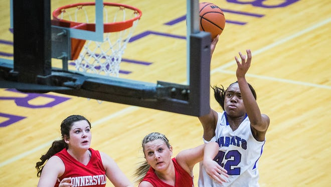 Central's Jayla Scaife shoots over Connersville's defense during their game at the Muncie Fieldhouse Tuesday, Dec. 15, 2015.