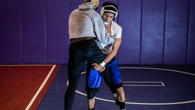 Central's Exuse Brown wrestles with a teammate during practice Tuesday, Jan. 26, 2016.