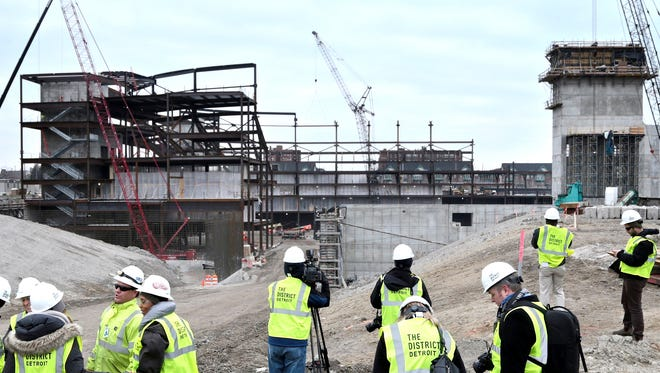 Members of the media look out over the construction site of the new Detroit Red Wings arena near downtown Detroit, Thursday, January 28, 2016.