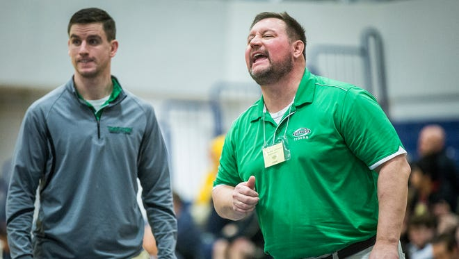 Yorktown coach Trent McCormick, right, yells instructions during the Delta Sectional at Delta High School Saturday, Jan. 30, 2016.