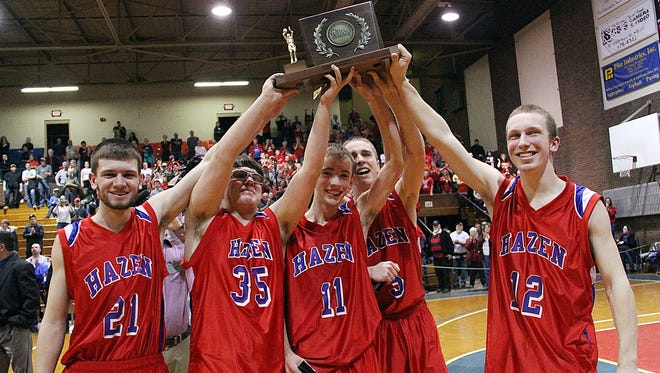 From left, Hazen seniors Kaleb Olsacher, Walden Gann, Kevin Doyon, Russell Shopland and Jazson Hussey hoist the tropy following their 63-43 win over Williamstown in the Division III high school basketball state championship game at Barre Auditorium on Saturday, Feb. 27, 2016.