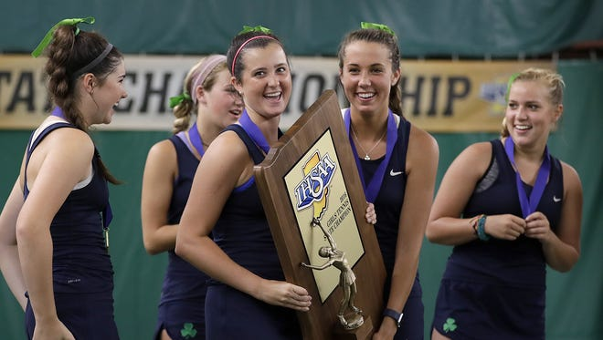 Seniors Grace Koscielski and Meghan Farrell, right, celebrate their team's state title win on Saturday.