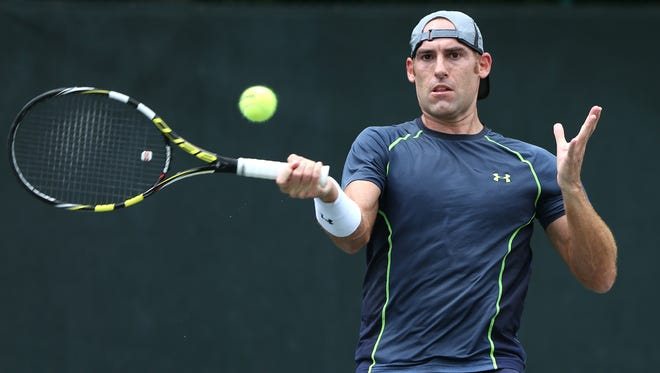 Robby Ginepri returns the ball against Joel Kielbowicz, not pictured, during the Pearson Ford Open tennis tournament at Woodstock Club, Sunday, June 21, 2015.  Ginepri won the match in two sets.