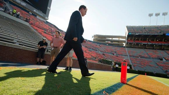 Auburn head coach Gus Malzahn walks onto the field before the game between Auburn and Arkansas State on Saturday, Sept. 10, 2016, at Jordan Hare Stadium in Auburn, Ala.