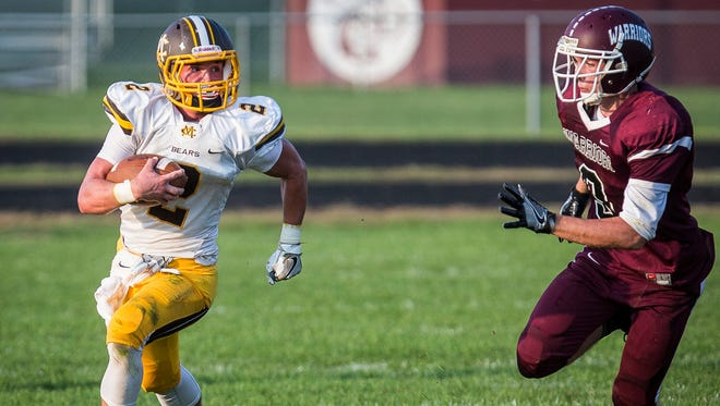 Monroe Central's Wyatt Snyder slips past Wes-Del's defense during their game at Wes-Del High School Saturday Sept. 24, 2016.
