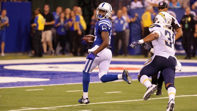 Indianapolis Colts wide receiver T.Y. Hilton (13) looks back as he heads into the end zone to score after a 63-yard touchdown reception during the second half of an NFL football game Sunday, Sept. 25, 2016, at Lucas Oil Stadium.