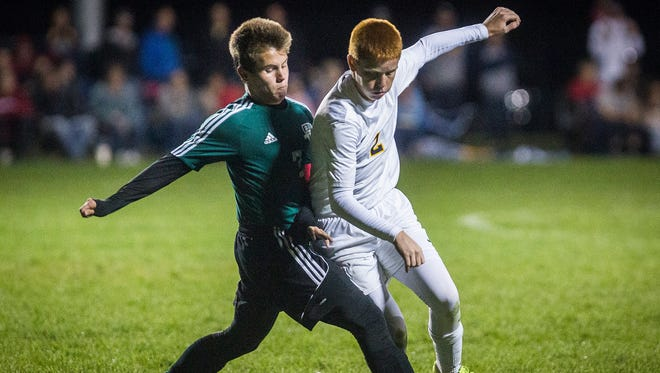 Delta's Cade Beckley pushes past Yorktown's Regan Frost during their game at the Yorktown Sports Park Saturday, Oct. 8, 2016. Delta defeated Yorktown 1-0 to win the sectional championship.