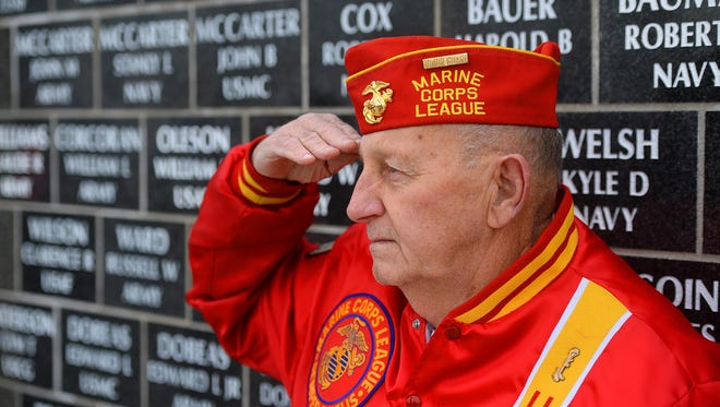 Herb Gilmour of the Marine Corps League detachment 688, salutes during the Veterans Day ceremony last year at the Montana Veterans Memorial.