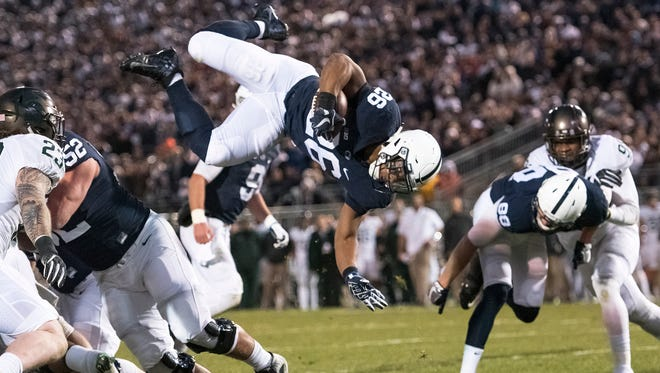 Penn State running back Saquon Barkley dives during Saturday's game against Michigan State.