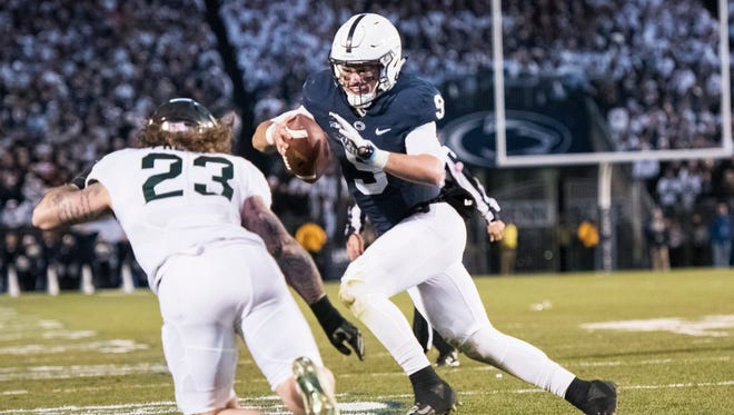 Penn State's quarterback Trace McSorley runs the ball while being pressured by Michigan State defense during a college football game against Michigan State on Saturday, Nov. 26, 2016, at Beaver Stadium. Penn State defeated Michigan 45-12.