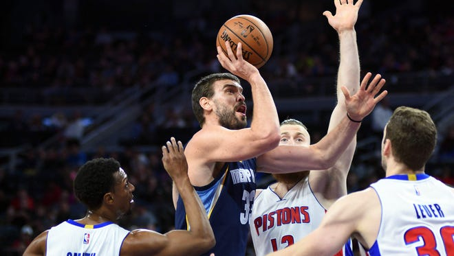 Dec 21, 2016; Auburn Hills, MI, USA; Memphis Grizzlies center Marc Gasol drives to the basket during the first quarter as Pistons guard Ish Smith (14), center Aron Baynes (12) and forward Jon Leuer (30) defend at the Palace.