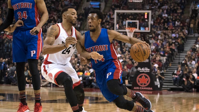 Feb 12, 2017; Toronto, Ontario, CAN; Pistons guard Ish Smith controls the ball as Raptors guard Norman Powell defends during the second quarter at Air Canada Centre.