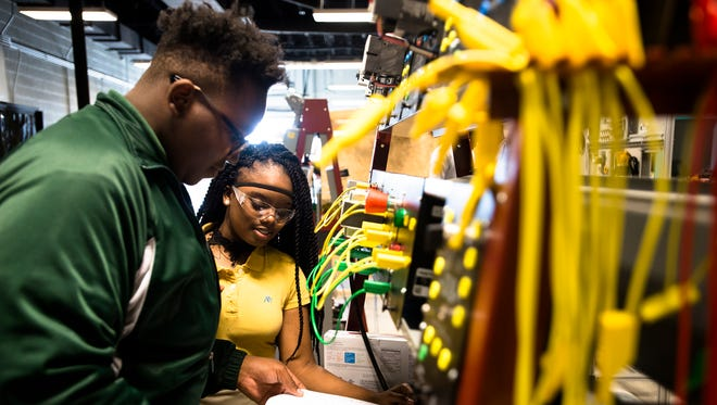 Shaniah Matthews and Brandon Jackson work inside the industrial repair area at MPACT (Montgomery Preparatory Academy for Career Technologies) during a statewide Career Tech Tour sponsored by the Alabama Department of Education, on Tuesday, Feb. 14, 2017, in Montgomery, Ala.